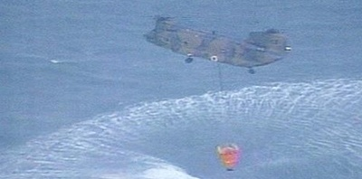 helicopters dumping water on the Fukushima nuclear power plant to cool it