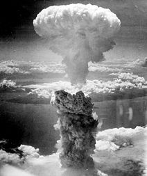 The mushroom cloud created by the Fat Man bomb resulting from the nuclear explosion over Nagasaki